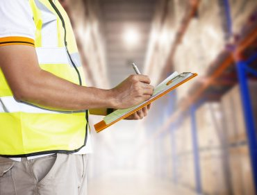 warehouse-staff-are-holding-clipboard-with-inventory-products-warehouse